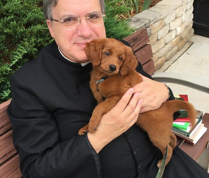 Fr. McDermott and the Golden Doodle!